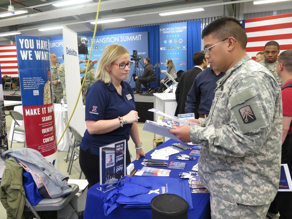 Transitioning Soldiers talk with employers and other career-related organizations during the first Transition Summit at U.S. Army Garrison Bavaria in November 2014. More than 35 organizations will be on-site at this year's career fair March 8 at Bldg. 134 on Rose Barracks.