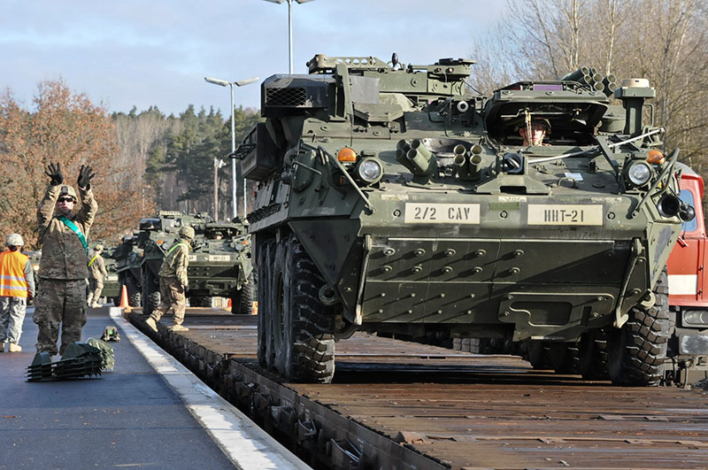 Troopers from 2nd Squadron, 2d Cavalry Regiment load their Strykers onto railcars as they deploy in support of Operation Atlantic Resolve from Rose Barracks, Germany, March 11, 2015. Under the Army's new focus on deployment readiness, USAG Bavaria has to find ways to gain efficiencies and reduce resources to buy the readiness we need to support the Army's mission, said Col. Mark Colbrook, garrison commander at USAG Bavaria. Photo by Sgt. William A. Tanner, 2nd Cavalry Regiment.