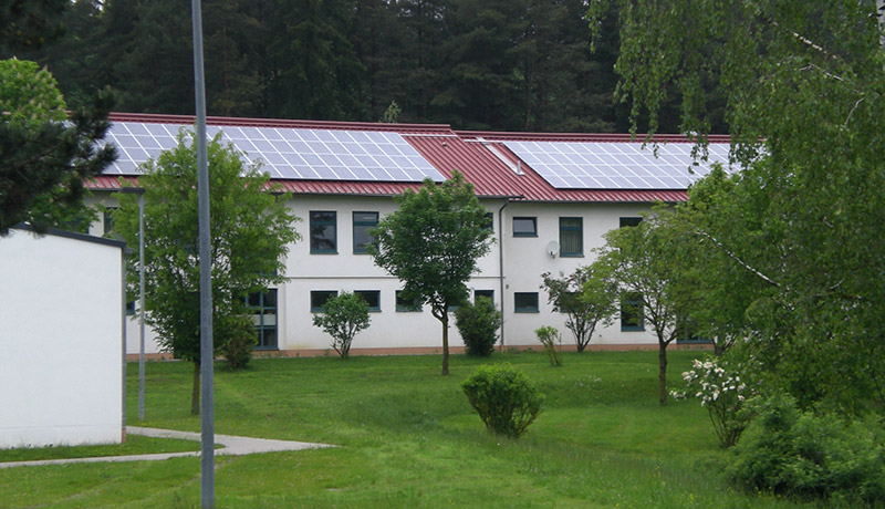 A roof-mounted photovoltaic system provides electricity to U.S. Army Garrison Bavaria housing.