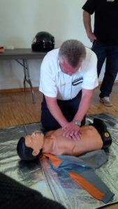 Andi Tuerk, Safety Manager, practices CPR. First Aid training was provided to Local National employees of the USAG Bavaria - Garmisch Community.
