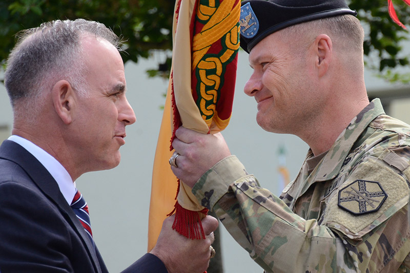 Col. Lance Varney, right, assumed command of U.S. Army Garrison Bavaria July 5. The ceremony and passing of the command's colors was presided over by Michael Formica, right, the region director of IMCOM-Europe.