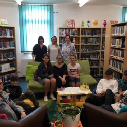 Teachers Edith Worden (back left) and Veronika Northam, along with Hohenfels' supervisory librarian Nancy Barker, pose with students from the Maedchenrealschule and Knabenrealschule during the annual English Reading Contest May 8 at Turnbull Memorial Library. (Courtesy Photo)