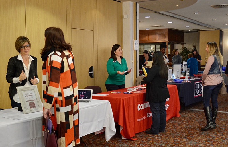 Spouses network with potential employers during a November 2017 career fair here hosted by U.S. Army Garrison Bavaria Army Community Service. (Photos by Porche Leonard, ACS)