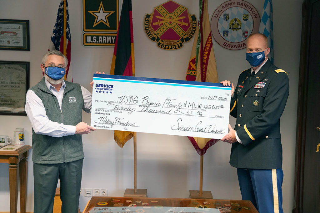 SCU Vice President of Overseas Operations, Philip R. von Streicher,  presented a check to garrison commander Col. Christopher R. Danbeck.